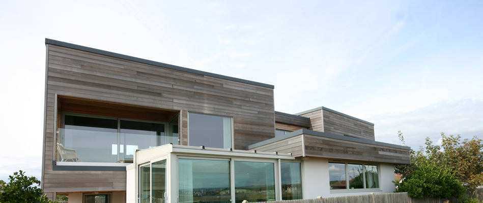 Additional storey, extension and refurbishment of bungalow by the sea
